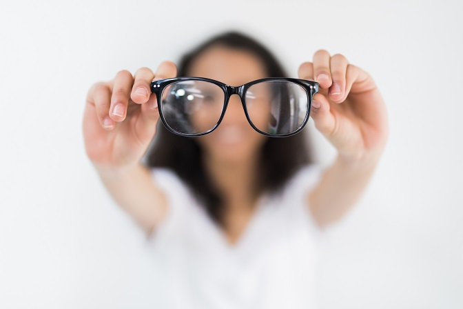 Glasses,-,Optician,Showing,Eyewear.,Closeup,Of,Glasses,,With,Glasses